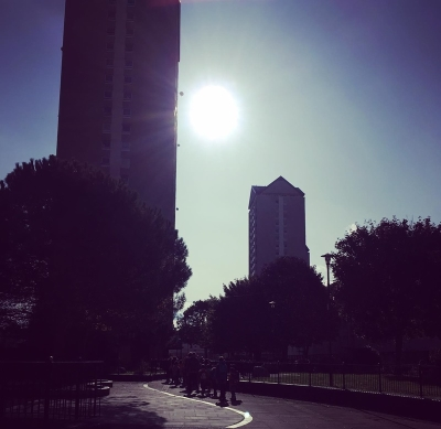 Sun Shining Between High Rise Buildings In Tower Hamlets, East London. UK.