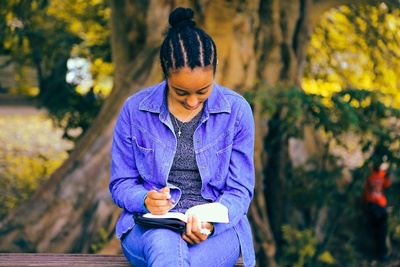 African Woman Sitting On Bench, Woman Writing In Book, Woman Taking Notes