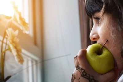 Girl Eating Green Apple.